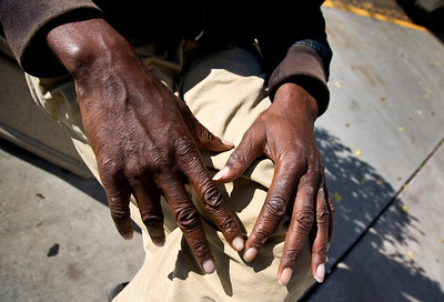 "the hands of ""happy guy"", a J Street regular."