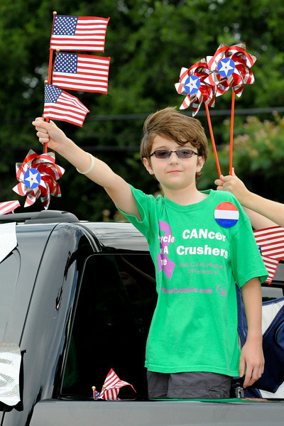 Justin Nacarato shows his patriotism on the CANcer Crusher truck during the Haslet 4th of July parade on July 3rd in Haslet.