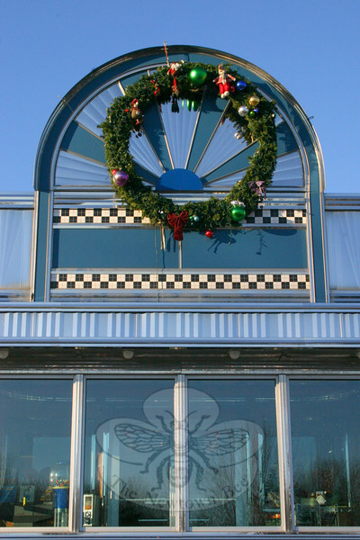 The wreath hanging on the side of Blue Colony Diner can probably be seen from I-84.  (Hicks photo)