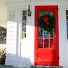 The red ribbon of this wreath's bow perfectly complements the red doors of 51 Main Street, Newtown.  (Hicks photo)