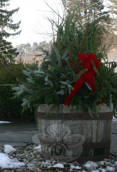 Pine cuttings and a red bow greet pedestrians and drivers going past Newtown Meeting House.  (Hicks photo)