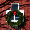 An oversize wreath with a simple red ribbon once again is hanging on the barn at the corner of Riverside Road and Sunnyview Terrace in Sandy Hook.  (Hicks photo)