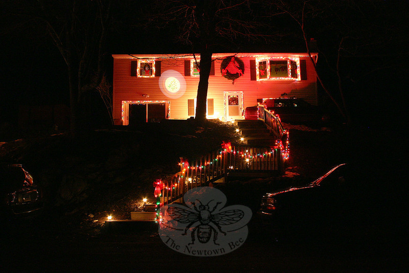 Christmas lights, a wreath and even a projected image all come together at one home on Sunnyview Terrace in Sandy Hook.  (Hicks photo)