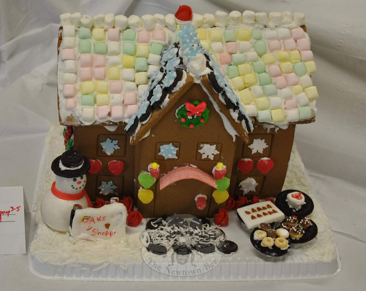 "This gingerbread Bake Shoppe, complete with doughnuts and cupcakes fashioned from ""O"" cereal shapes, and an Oreo cookie walkway, won first place for Courtney Cohane and Sophia Andrew in the Child Group Division, Grade 3–5.  (Crevier photo)"
