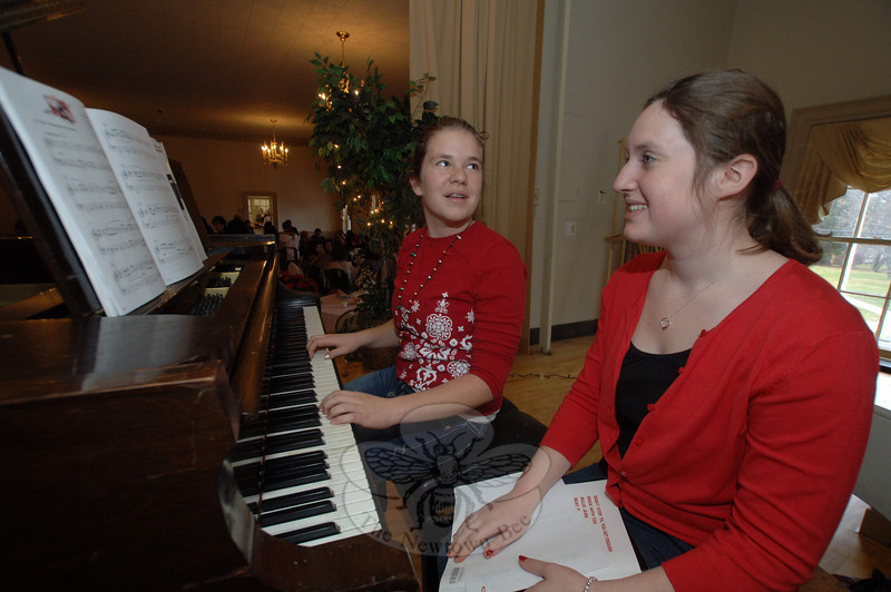 Sisters Emily and Elizabeth Charash play gentle piano music during the Victorian Tea in the Alexandria Room Sunday, December 5.  (Bobowick photo)