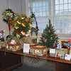 Several tables will filled with offerings during the Festival of Trees, a two-day event that is part of Newtown Holiday Festival to benefit Newtown Youth & Family Services. This year's event ran December 4-5 in the lower community room at C.H. Booth Library. The event showcased locally crafted trees, holiday decorations, and gift baskets donated for the annual raffle to support the family support center.  (Crevier photo)