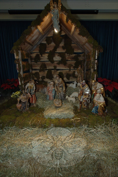 "On display during the St Rose ""You Can Never Have Enough Christmas"" Boutique were manger scenes from Monsignor Robert Weiss's personal collection, ""based on scenes from around the world."" He had asked parishioners to create the displays, and was ""amazed"" at the result. The displays were ""wonderful,"" he said.  (Bobowick photo)"