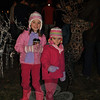 """Leah McCafferty, 7, and sister Abby, 5, visit with Santa's reindeer during the prelighting """"social hour,"""" Friday evening, December 3, at the Annual Tree Lighting in Ram Pasture.  (Crevier photo)"""
