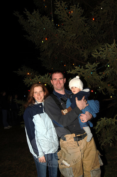 Hook & Ladder Chief Jason Rivera with his wife Christine and their son Evan at the Ram Pasture Tree lighting Friday night. Mr Rivera was one of two people who had the honor of throwing the switch to light the town's tree this year.  (Bobowick photo)