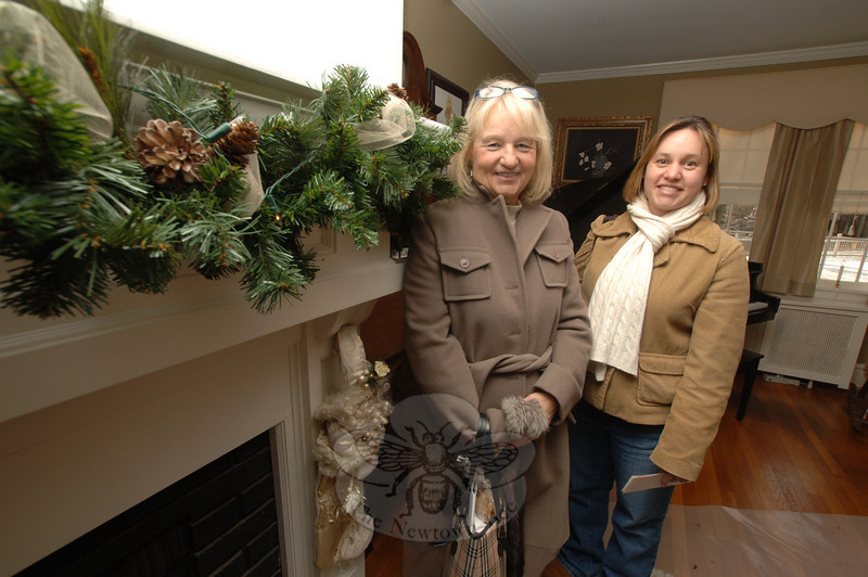 Among those enjoying the fireside decorations at 10 Main Street druing the Holiday Festival were Freida Potok and her daughter Michelle Wittko.  (Bobowick photo)