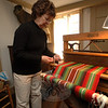 Rebecca Arkenberg offered an ongoing demonstraton of weaving at The Matthew Curtiss House, which was open during the hours of Newtown's Holiday Festival on December 6.  (Bobowick photo)