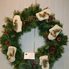 Beautifully decorated tabletop trees and other holiday decorations donated by various individuals and organizations filled the tables and walls at the Festival of Trees, one of this year's Holiday Festival events. Visitors purchased chances to win the creations, such as this Mitten Wreath donated by Patty Fogelstrom, with funds raised going to benefit Newtown Youth & Family Services.  (Crevier photo)