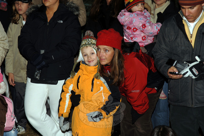 Watching carolers during the tree lighting at Ram Pasture on Friday, December 4, 2009.  (Bobowick photo)