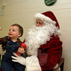 Benjamin Cocozza sat on the big guy's lap during Breakfast With Santa at Newtown Middle School on Saturday, December 5.  (Bobowick photo)
