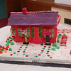 Dianne and Scott Orlando took first place in the Adult Division of the Holiday Festival's Gingerbread House Contest with their deep pink and purple confectionary rendition of the old Newtown Railroad Station.  (Crevier photo)
