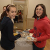 Victorian Tea attendees Stephanie Haas and Emily Zmek said they both preferred the raisin-filled scones.  (Bobowick photo)