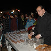 Vinnie DiGilio helped serve warm refreshments during the tree lighting at Ram Pasture on Friday, December 4, 2009.  (Bobowick photo)