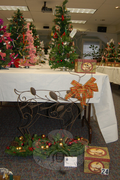 A metal reindeer stepping through a bed of greens, donated by Ann Montgomery, was one of the more unusual offerings at the Festival of Trees held at C.H. Booth Library on Saturday and Sunday, December 5-6.  (	Crevier photo)