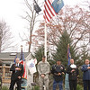 Heads were bowed as a number of local service members and veterans stood beneath the flagpole during Wednesday's Veterans' Day ceremony at VFW Post 318.  (Bobowick photo)