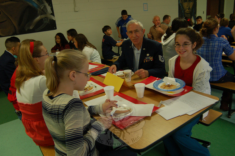 Newtown Middle School student Kayleigh Granville, right, sits next to her grandfather John Casserly, who served with the Army then the Air Force, during the Veterans Day Breakfast on Wednesday, November 11, at the school. (Hallabeck photo)