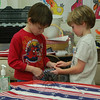 Hawley School second graders Nick Preszler, right, and Devin Johnson fold an American flag to send to a troop of soldiers from Fairfield County currently on tour in Afghanistan with the rest of their class on Veterans Day, Wednesday, November 11.  (Hallabeck photo)