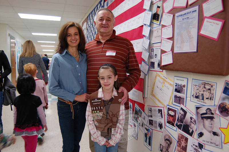 Nicholas P. Fatse visited Hawley Elementary School with his daughter Andrea Brosnan, left, and granddaughter Olivia Brosnan, right, during Veterans' Day celebrations at the school. Olivia posted the names of Mr Fatse and her other grandfather, Frank Brosnan, along on a wall in the school set as a decoration of all veterans connected to Hawley students.  (Hallabeck photo)