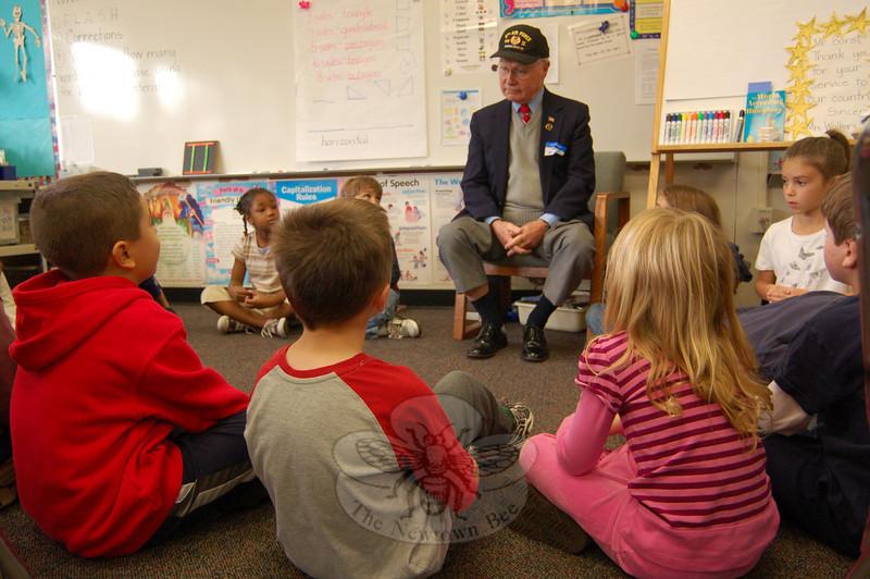 First Selectman Joseph Borst visited Robin Walker's second grade classroom on Veteran's Day, Wednesday, November 11, just before the school's Veterans Day Breakfast began.   (Hallabeck photo)