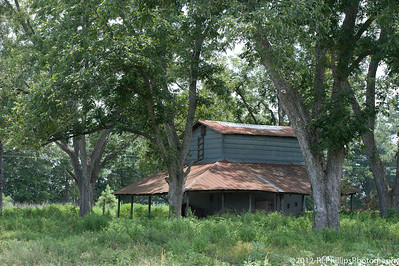 An old farm building at the entrance to Carlos Vickers cotton field.  Carlos Vickers was named Farmer of the Year in 2011.  You can learn more about him by visiting:  http://www.youtube.com/watch?v=uFNNO5SQ5nI