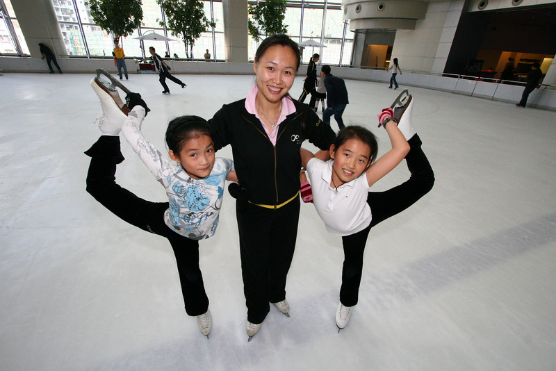 Chen Lu with her students at the World Ice Arena in Shenzhen. Copyright © 2007 Jesse Warren. For Features.