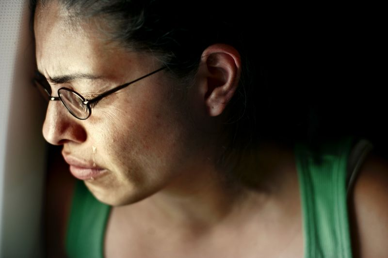 6/30/2005 -- Landing in El Salvador --  Imelda Auron looks over the countryside of her birth country and remembers the brutal murder of her parents and sisters years ago. When the airplane landed at the airport, Imelda's cheeks were streaming with tears. Story by Yvonne Abraham; Photo by Dina Rudick, Boston Globe Staff