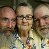 James Copas, 52 (left) and Harold Copas, 62 (right) sit on the front porch with their mother Mildred Walker, 89 as they enjoy the summer breeze and making their mother laugh.