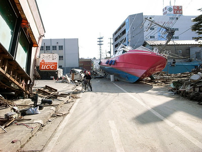 Boats were swept into the streets from the nearby river.