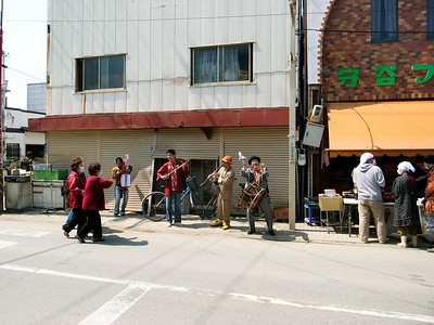 A band trying to cheer up the local people.