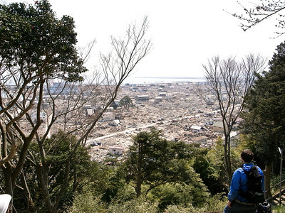 The view of the devastated port area from the nearby hill.