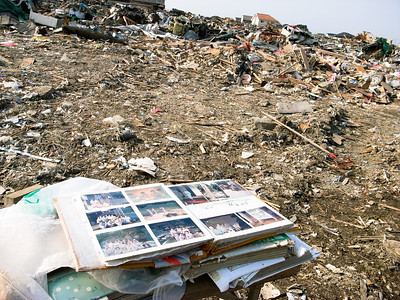Photo albums resuced from the debris show the photos of people who probably lost their life.