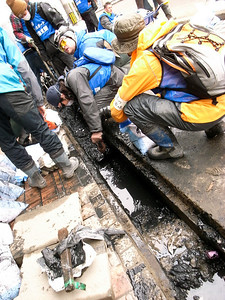 Thick, oily mud plugged the water drainage tunnels.