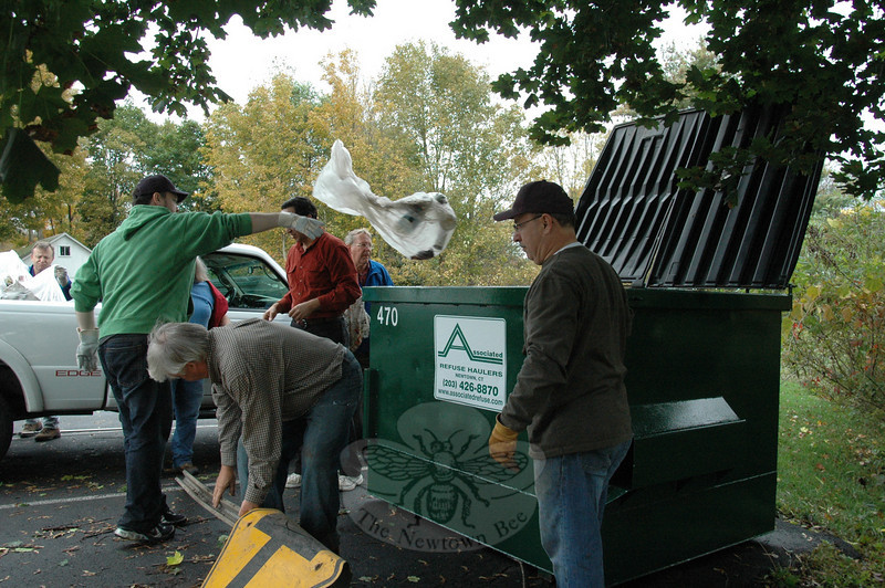 Local volunteers, including members of Boy Scout Troop 770 and members of Newtown Rotary, participated in a Make a Difference Day project on Saturday, October 10, cleaning trash from the area of local waterways and roads. (Voket photo)