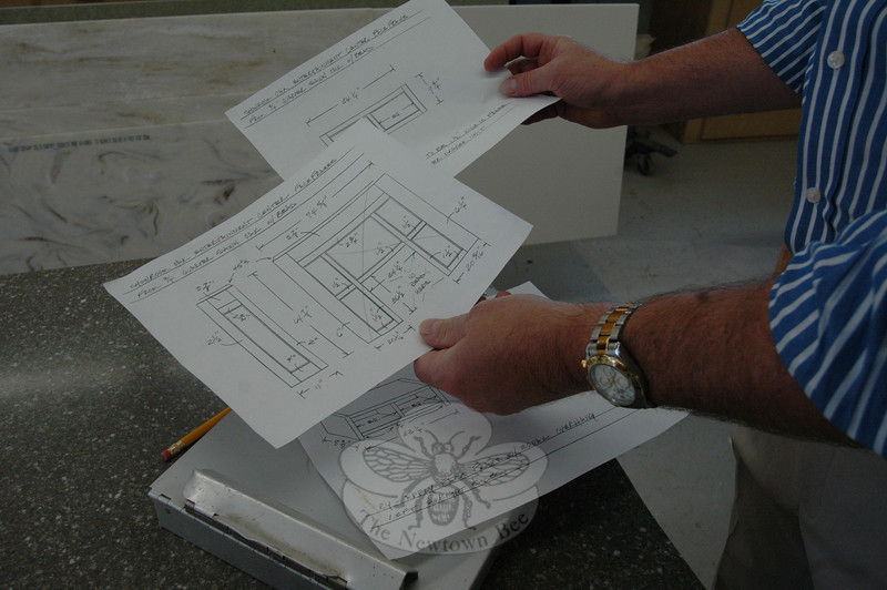 Hand-rendered preliminary plans for several custom cabinet configurations are provided to woodworkers in the cabinet shop on location at the Architectural Kitchens & Baths showroom.  (Voket photo)