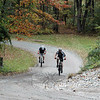 Pat Gigliotti of Bethel, left, and Mike Ahern of Danbury pedal through the second of five grueling laps at the second annual Grapes of Wrath cross country bicycle race held at McLaughlin Vineyard on October 10.  (Voket photo)
