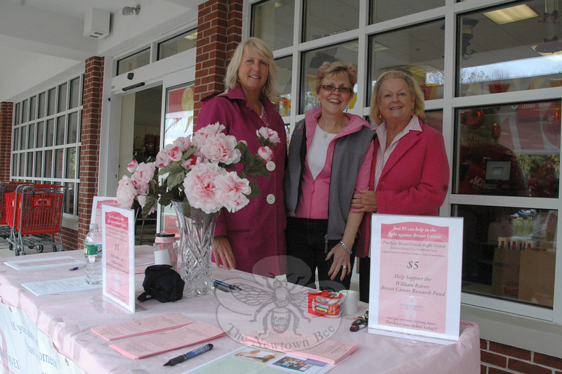 William Raveis Real Estate, Mortgage & Insurance office staff is sponsoring its fifth annual Breast Cancer Awareness Month fundraisers. On Saturday, October 10, sales manager Valda Thompson, center, was joined by Tracey Smith and Jackie Zvon, left, at the grand opening of Ace Hardware on Church Hill Road, selling $5 raffle tickets in exchange for a chance to win any of 20 prizes. (Voket photo)