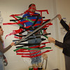 Newtown High School senior Sam Kent, left, helped school secretary Debi Modzelewski duct tape science teacher Trent Harrison to a wall outside the school's cafeteria on Monday, October 12, during an event to raise money for Schools for Schools, a program of the nonprofit organization Invisible Children.  (Hallabeck photo)