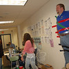 Newtown High School students took turns adding pieces of duct tape to a wall outside the school's cafeteria on October 12, all in an effort to tape science teacher Trent Harrison to the wall. Each student had made a donation that allowed them to attach a piece of tape to the project, which was the culmination of a fundraiser for Schools for Schools's Invisible Chuldren project.  (Hallabeck photo)