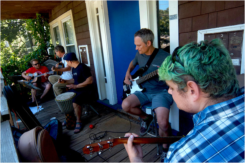 Brown House Band plays on a porch high above Chetnut Avenue.