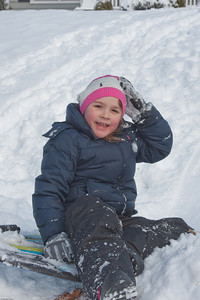 (1) Pslip Slug #: (Pending); (2) Ridgewood, NJ; (3) 01/12/2011; (4) Ridgewood Responds to Another Snow Storm; (5) Grace holds on to her hat after a fast sled run on 1/12/2011; (6) W.H. Grae for the Ridgewood News.