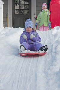 (1) Pslip Slug #: (Pending); (2) Ridgewood, NJ; (3) 01/12/2011; (4) Ridgewood Responds to Another Snow Storm; (5) Courtney takes off, as her friend, also Courtney, waits her turn on 1/12/2011; (6) W.H. Grae for the Ridgewood News.