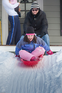 (1) Pslip Slug #: (Pending); (2) Ridgewood, NJ; (3) 01/12/2011; (4) Ridgewood Responds to Another Snow Storm; (5) Ellen McKenna gives Brooke a push to start her down the slope on 1/12/2011; (6) W.H. Grae for the Ridgewood News.