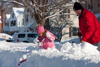 (1) Pslip Slug #: (Pending); (2) Ridgewood, NJ; (3) 01/12/2011; (4) Ridgewood Responds to Another Snow Storm; (5) Gabriella helps Carle Funke clear a path on Reynen Court on 1/12/2011; (6) W.H. Grae for the Ridgewood News.