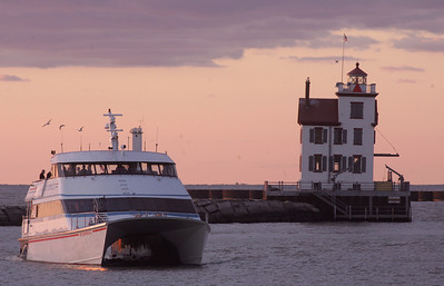 30SEP09  The Put-in-Bay Jet Express IV tours the inner harbor of Lorain at sunset.  photo by Chuck Humel