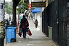 Unidentified homeless man walks down Haight Street, San Francisco, California, at 8am on October 1, 2010.   Photo by Alex Woo.