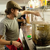 Chef Tim Peters prepares Thai boiled peanuts in the kitchen at Motor Supply Co. Bistro.